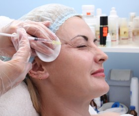 Middle-aged female facial botox injection Stock Photo 05