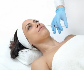 Middle-aged female facial botox injection Stock Photo 06