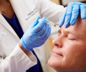 Middle-aged male facial botox injection Stock Photo