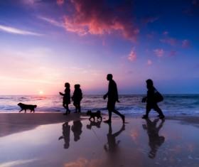 People walking on the beach Stock Photo