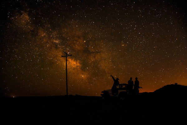 People watching sparkling starry sky at night Stock Photo