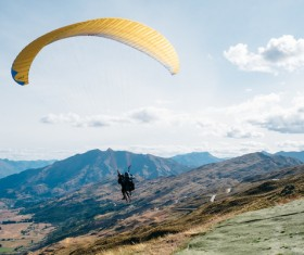 Person extreme with parachute flying recreation Stock Photo