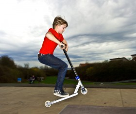 Play scooter little boy Stock Photo 01