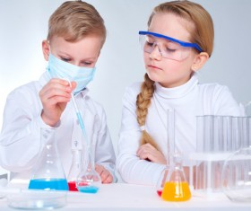 Pupil doing chemistry experiment Stock Photo