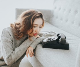 Red lips girl waiting by the phone Stock Photo