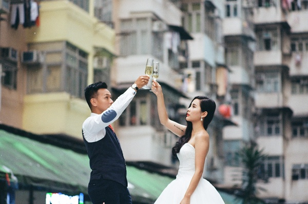 Romantic young couple cheering with wine Stock Photo