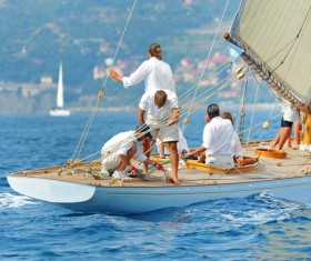 Sailing crew to put rigging in order Stock Photo