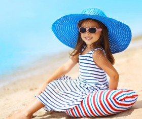 Sitting on the beach elegant little princess Stock Photo