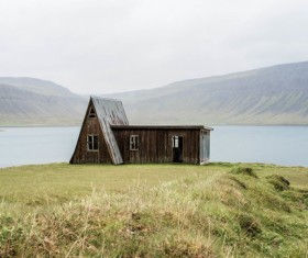 Small wooden house beside the lake Stock Photo