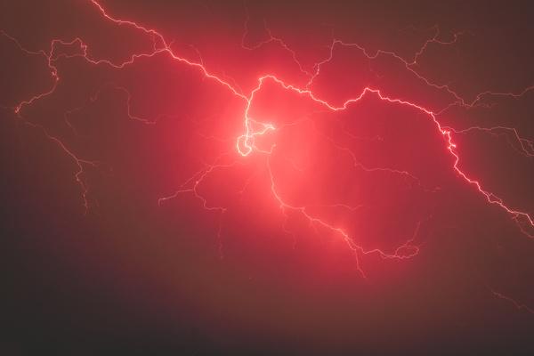 Sparkling red thunder on sky Stock Photo
