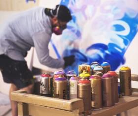 Street graffiti and paint bottles Stock Photo