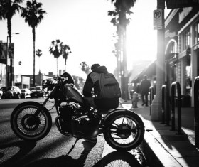 Street young man sitting on a motorcycle Stock Photo