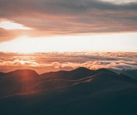 Sunset on high mountain peak Stock Photo