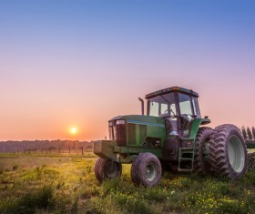 Tractor parked in the farmland Stock Photo