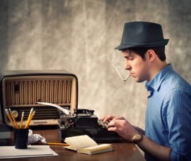 Use old-fashioned typewriter typing man Stock Photo