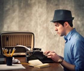 Use old-fashioned typewriter typing man Stock Photo