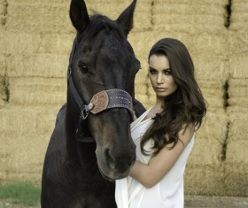 Woman and black horse Stock Photo