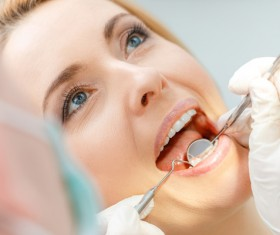 Woman doing dental care Stock Photo 04