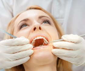 Woman doing dental care Stock Photo 07