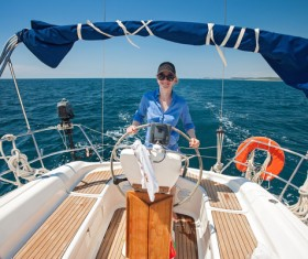 Woman driving a yacht Stock Photo