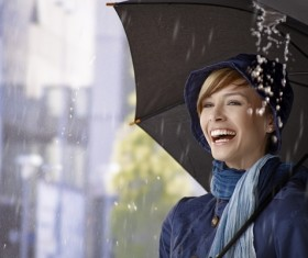 Woman having fun with umbrella on rainy day Stock Photo 01