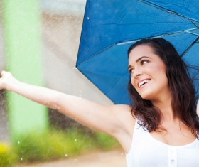 Woman having fun with umbrella on rainy day Stock Photo 02