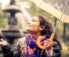 Woman having fun with umbrella on rainy day Stock Photo 03