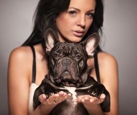 Woman holding pet dog Stock Photo 03