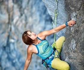 Woman rock climber climbs Stock Photo 03