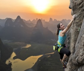 Woman rock climber climbs Stock Photo 04