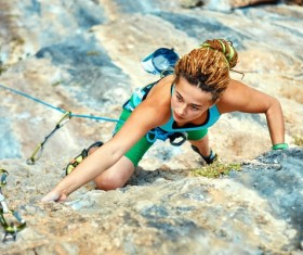 Woman rock climber climbs Stock Photo 05