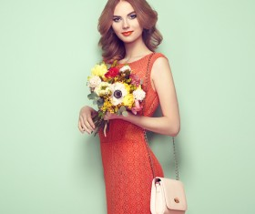 Woman wearing red dress holding flowers pose Stock Photo 01