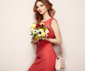 Woman wearing red dress holding flowers pose Stock Photo 02