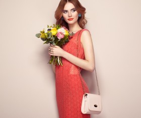 Woman wearing red dress holding flowers pose Stock Photo 03