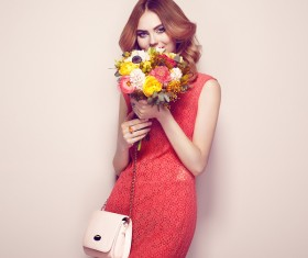 Woman wearing red dress holding flowers pose Stock Photo 04