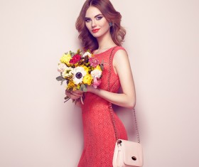 Woman wearing red dress holding flowers pose Stock Photo 05
