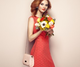 Woman wearing red dress holding flowers pose Stock Photo 06