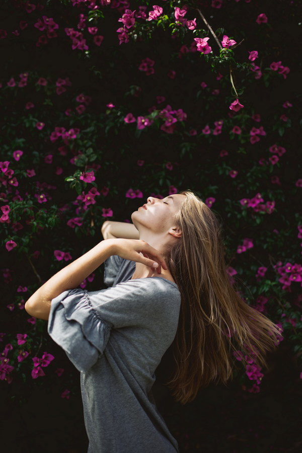Woman with flower wall Stock Photo