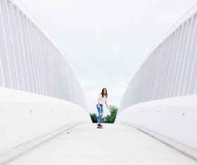 girl play roller skating on white bridge Stock Photo