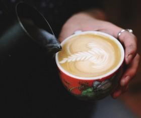 man holding beautiful milk coffee cup Stock Photo