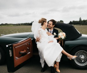 married couple posing on classical car Stock Photo
