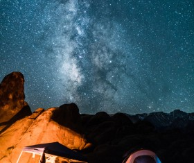 mountain camping under sparkling starry sky Stock Photo