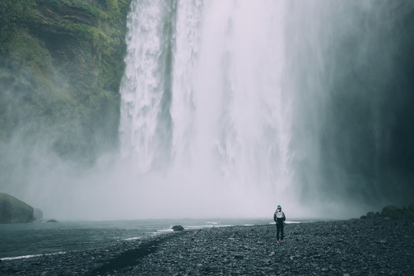 person in front of beautiful waterfall Stock Photo