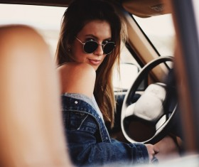 Attractive stylish woman posing in car Stock Photo