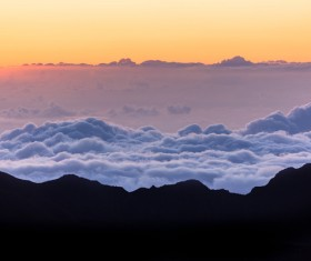 Beautiful cloudscape on high mountain range Stock Photo