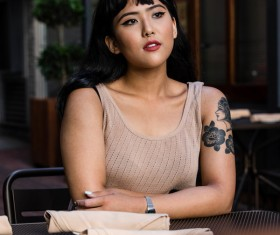 Beautiful stylish tattoo asian woman Stock Photo