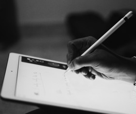 Black white picture of hand writing smart device Stock Photo