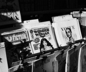Black white picture of magazines shelf on street Stock Photo