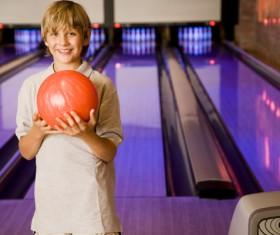 Boy playing bowling Stock Photo