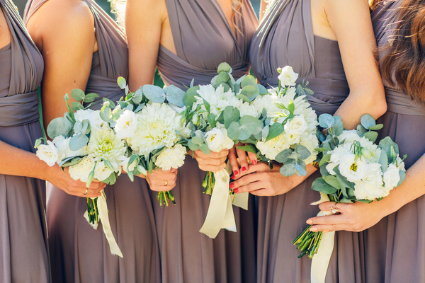 Bride and bridesmaid holding bouquet Stock Photo 03